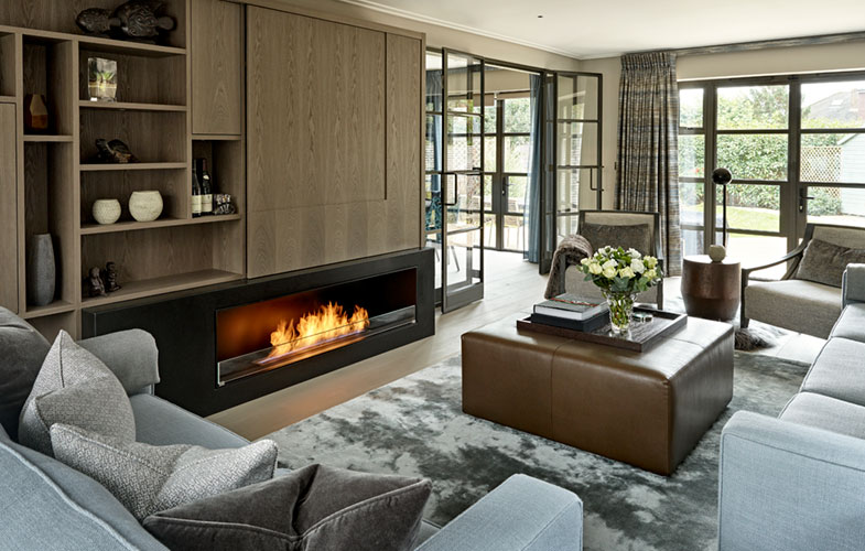 Sitting/Living room with built-in media wall and display cabinet. AV furniture in dyed grey ash with Matt-black stone fireplace.