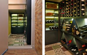 Entrance to wine room design in Lambeth, South London with tiled floor, bespoke wine display cabinetry and tiled floor.