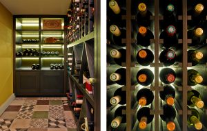 Wine room design in Lambeth home - Mediterranean style wine cellar with dark wood display cabinet and vertical wine racks with tiled flooring.