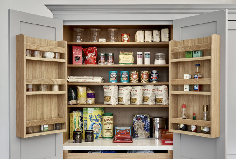 Top of open shaker style pantry in grey with natural oak interior