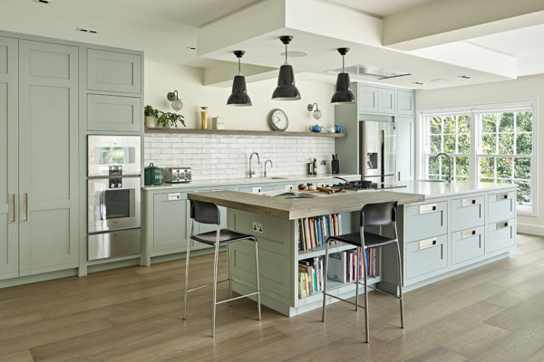 Modern shaker kitchen design with pale green cabinets and brushed stainless steel handles
