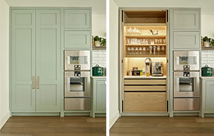 Side by side images of open and closed modern shaker pantry / breakfast cabinet in pale green with brushed stainless steel handles. With pocket doors that open fully to reveal light wood interior, power supply and automatic lighting inside.
