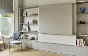 Modern Media Wall with display cabinet for Period home with sliding panel.