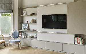 Contemporary AV Furniture and Display Cabinet for period living room with sliding panel to hide away the TV