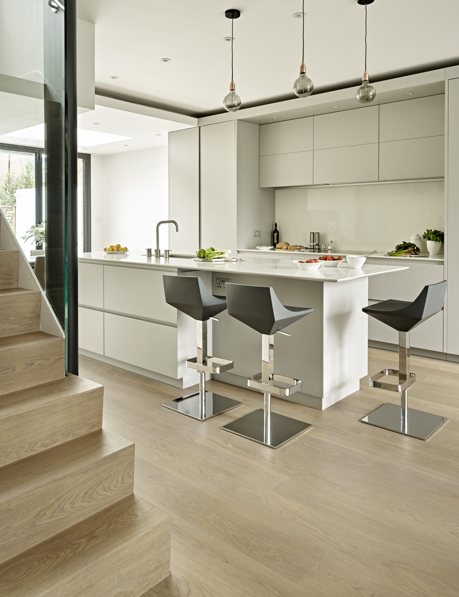 Minimalist Grey Kitchen design in Wimbledon with modern island and handless cabinets