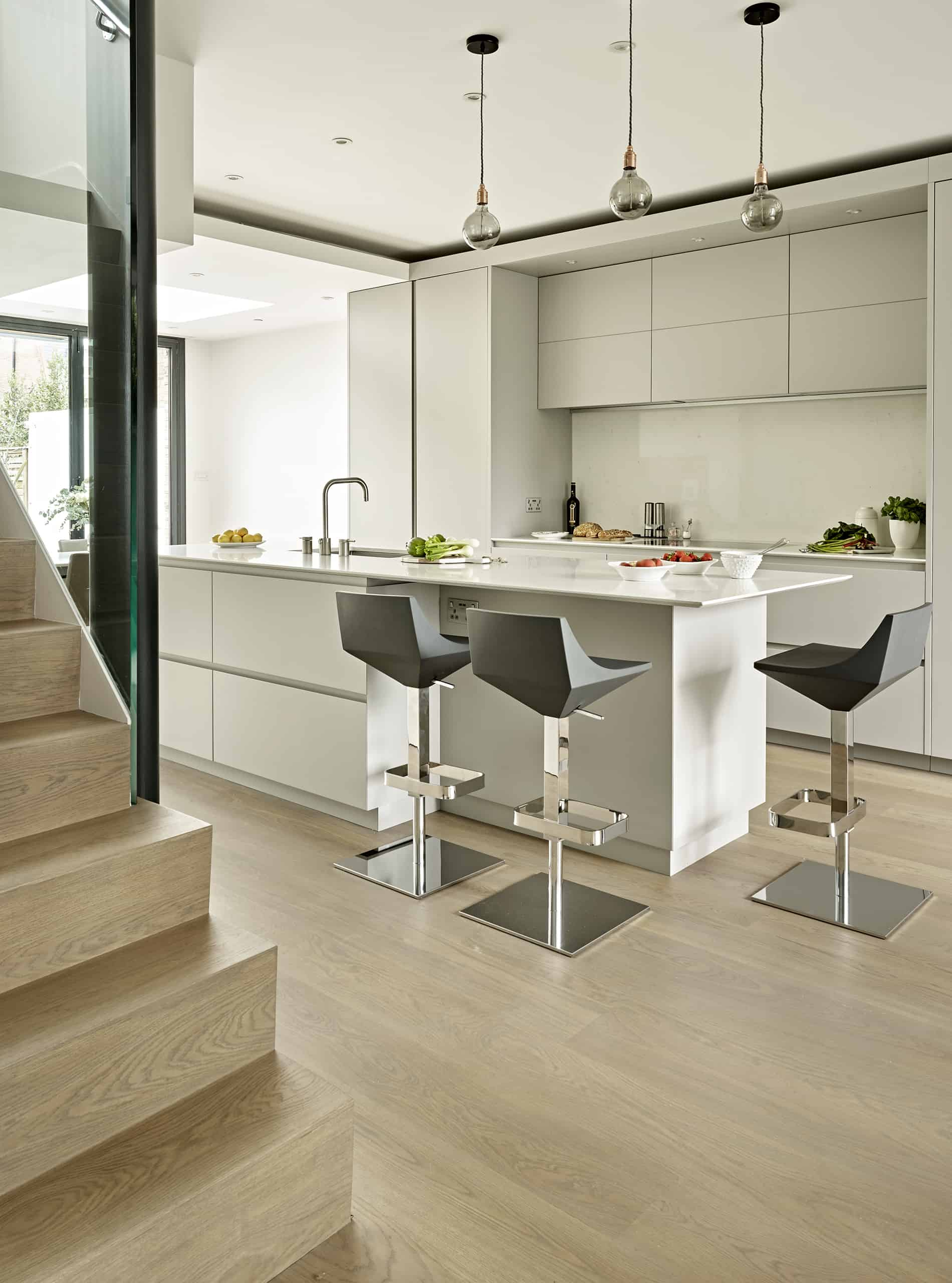 Wimbledon light grey contemporary kitchen design with central island and breakfast bar