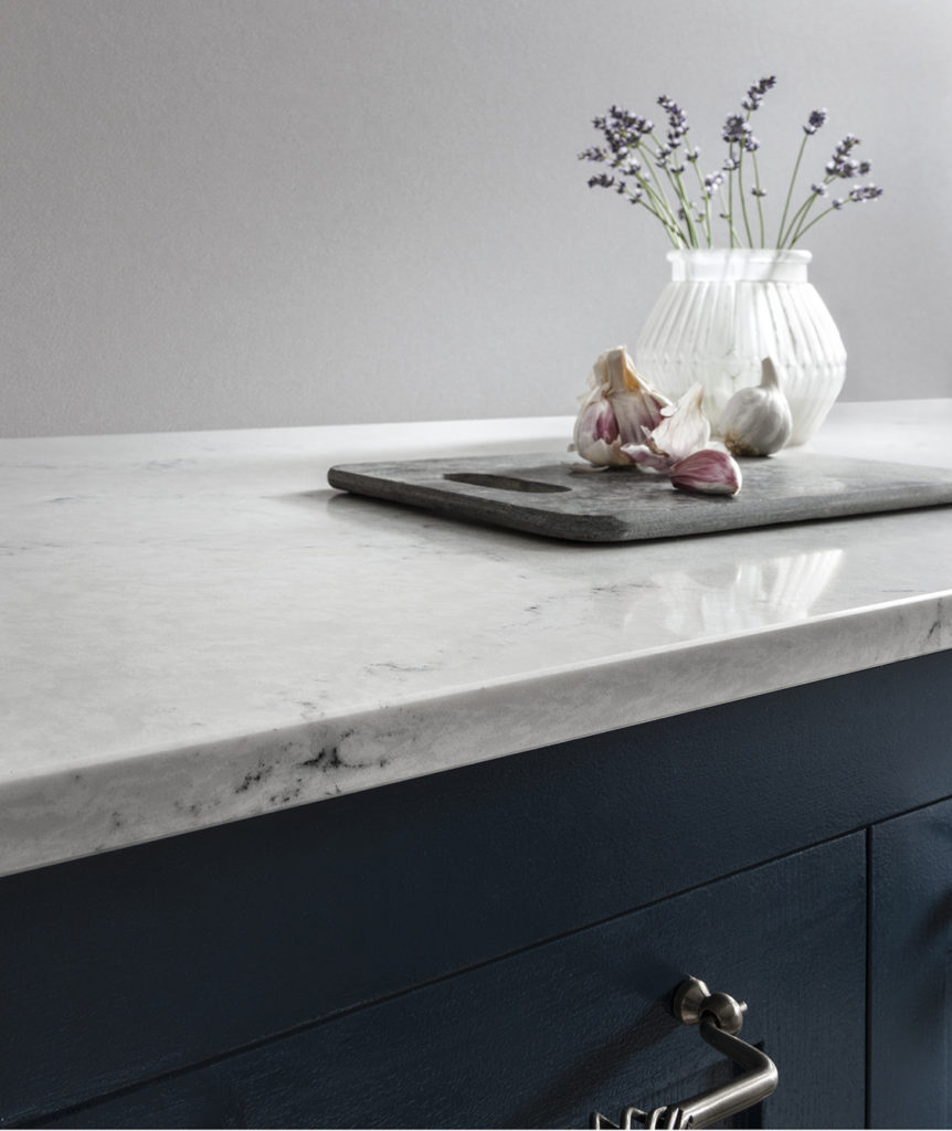 Marble-effect Radianz Orion worktop with dark navy kitchen cabinets