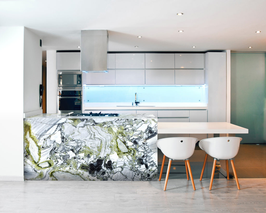 White beauty polished island worktop in a modern kitchen - white and black withwith green vein