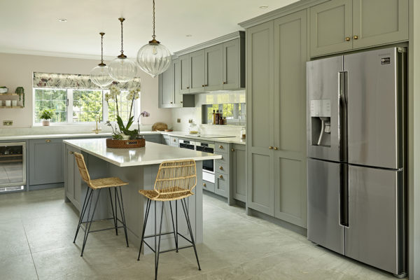 Brayer Design English country cottage style kitchen with gray shaker cabinets