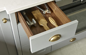 Kingswood kitchen hand painted drawer in grey with walnut interior and burnished brass cup handle