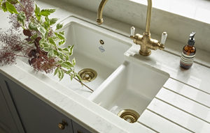 Sink Area with drainer, brass tap and composite quartz worktop with built-in draining board