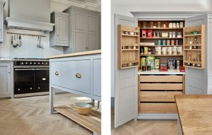 Grey country kitchen with island, range and pantry cabinet with light oak interior.