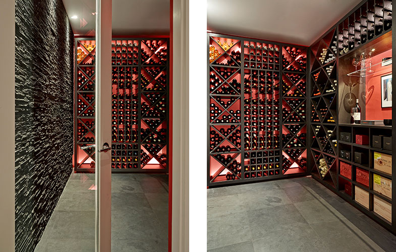 Temperature controlled wine room with slate wall and coral backlit wall - bepoke wine racks and display cabinetry