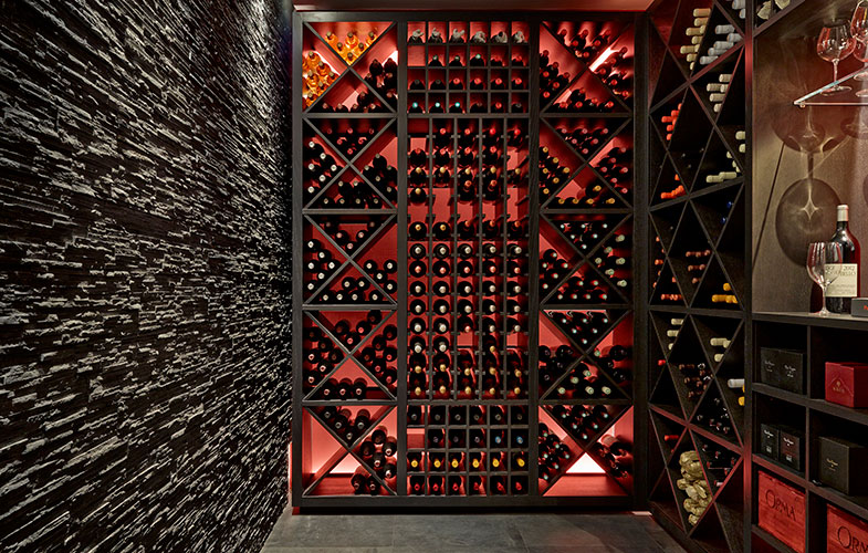 Wine room/cellar with slate wall and bespoke storage
